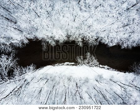 Aerial View Of Snowy Forest And Stream