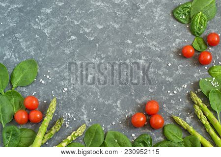 Fresh Organic Vegetables: Asparagus, Spinach And Cherry Tomatoes. Frame Of Vegetables And Sea Salt O