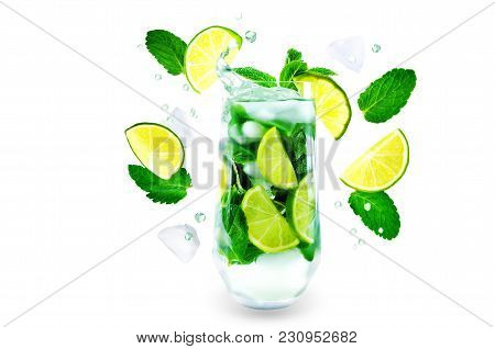 Mojito Coctail  With Fresh Flying Mint Leaves, Ices And Lime Slice Isolated
