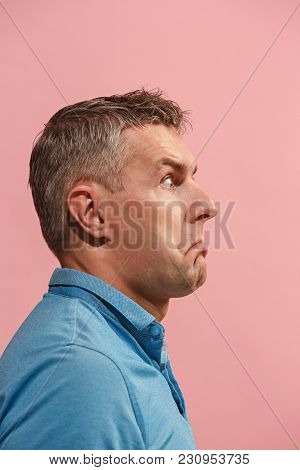 Why Is That. Beautiful Male Half-length Portrait Isolated On Trendy Pink Studio Backgroud. Young Emo