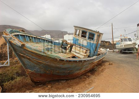 Old Abandoned Fisherboat Shipwreck At The Coast