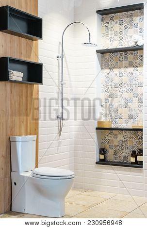 White Ceramic Toilet Bowl In The Bathroom