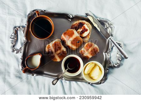Breakfast On A Silver Tray On Blue Sheets On The Bed. Scones With Jam And Butter, And Hot Strong Cof