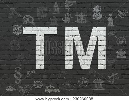 Law Concept: Painted White Trademark Icon On Black Brick Wall Background With Scheme Of Hand Drawn L