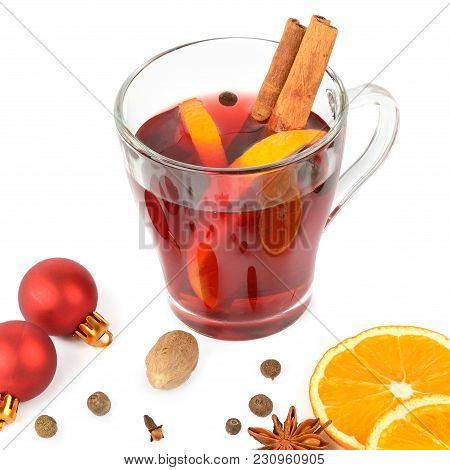 Hot Red Mulled Wine Isolated On White Background With Spices, Orange Slice, Anise And Cinnamon Stick
