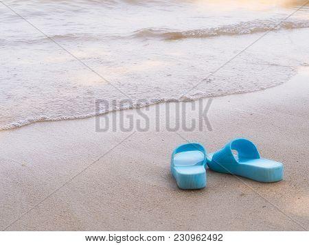 Flip Flops , On A Sandy Ocean Beach. Vacation Concept.