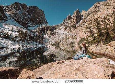 Woman tourist near Emerald Lake at autumn in Rocky Mountain National Park. Colorado, USA.