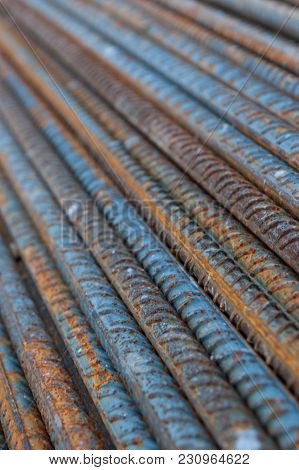 Closeup Of A Pile Of Rusty Construction Steel Rods