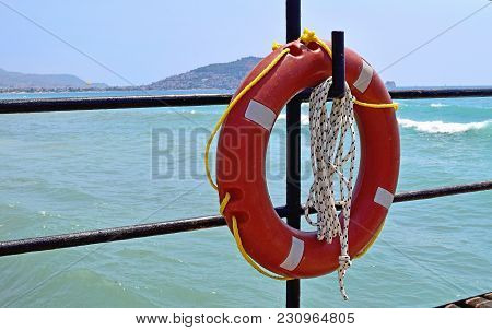 Lifebuoy Hanging On The Hook Background Of The Sea