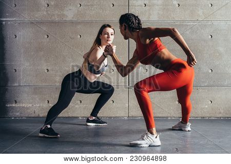 Fit Woman Wrestle On Hands With A Female Opponent Looking In Her Eyes