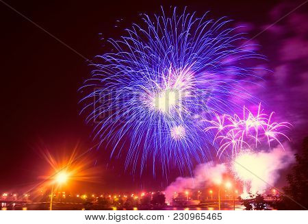 Festive Firework Over The City In Ultraviolet Neon Light