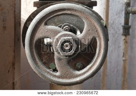 A Large Rusty Water Valve On A Construction Site