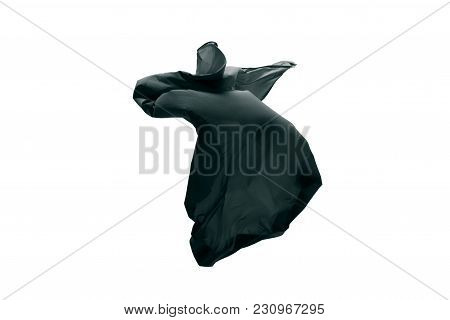 Smooth Elegant Transparent Black Cloth Separated On Gray Background. Texture Of Flying Fabric.