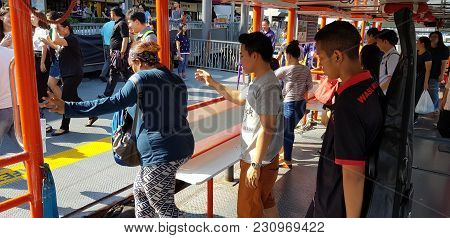 Bangkok, Thailand-march 2, 2018: Thai People And Passenger Take Thai Ferry Boat To Crossing The Chao