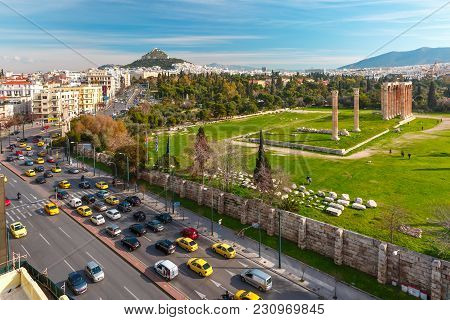 Aerial City View With Ruins And A Columns Of The Temple Of Olympian Zeus, Mount Lycabettus In The Ba