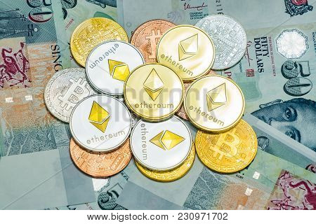 Singapore Dollar Banknotes And Bitcoin Cryptocurrency And Ethereum Coins On White Background