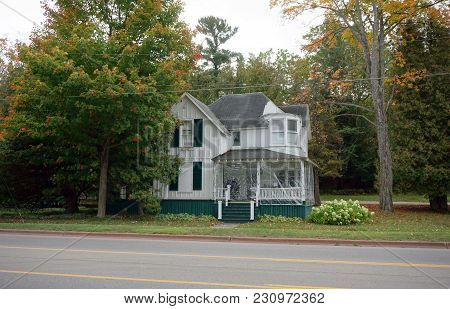 Bay View, Michigan / United States - October 16, 2017: A White Two Story Victorian Cottage, Its Fron