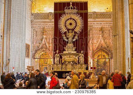 Seville - Mar 16: Unidentified Tourists Visit Seville Cathedral Impressive Monstrance On March 16, 2