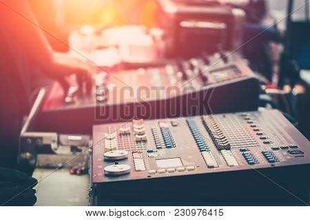 Professional Stage Sound Mixer Closeup At Sound Engineer Hand Using Audio Mix Slider Working During