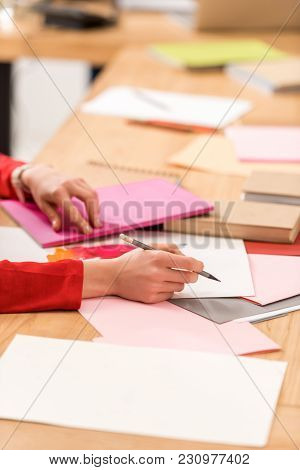 Cropped View Of Magazine Editor Working With Documents In Modern Office
