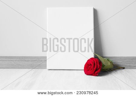 Mockup Poster Frame And Red Rose.neutral Gray Wall And Floor On Background.