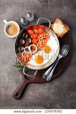 Full English Breakfast With Fried Eggs, Beans, Toasts, Tomatoes , Mushrooms And Coffee On Grey Backg