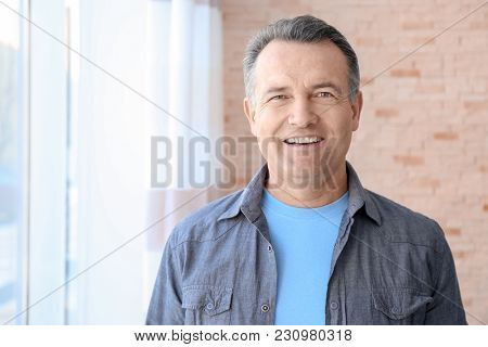 Portrait of male pensioner at home