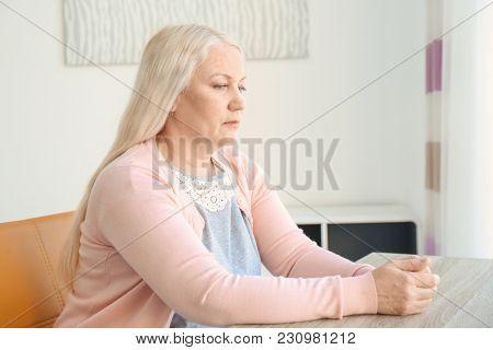 Portrait of female pensioner at home