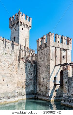 Italy September 2017. Sirmione. Medieval Castle Scaliger On Lake Garda.