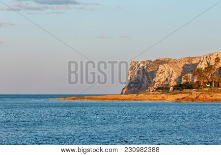 Evening Summer Mediterranean Sea Rocky Coast View And Cape Sant Antoni In Far (denia, Alicante Regio