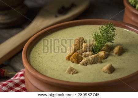 High Angle View Of Fresh Creamy Broccoli Soup Decorated With Croutons And Fresh Dill Leaves. Selecti