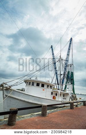 Savannah, Georgia - March 1, 2018: A Shrimp Boat Is Tied Up On The River Street Dock On The Savannah
