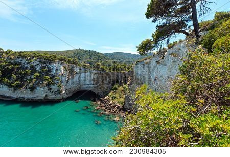 Summer Sea Coast Near Architello (arch) Of San Felice On The Gargano Peninsula In Puglia, Italy