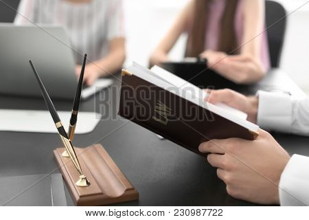 Lawyer having meeting in office, closeup