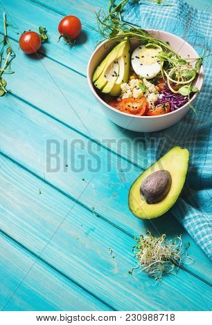 Healthy Vegan Lunch Bowl. Vegan Buddha Bowl. Vegetables And Nuts In Buddha Bowl On Blue Wood Backgro
