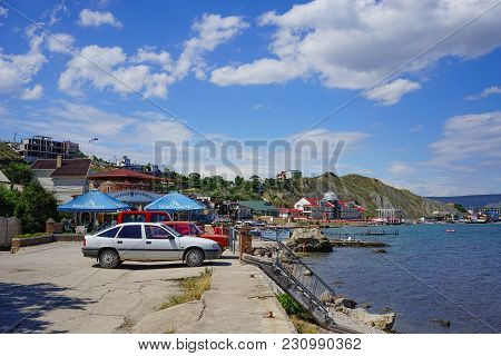 Koktebel, Crimea-june 27, 2015: Seascape Coastline Resort Town With Hotels And Cars In The Parking L