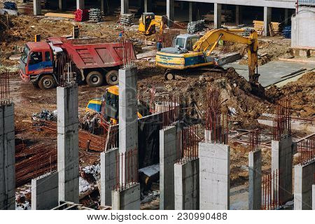 Machinery And Bulldozer With Ground And Beam At Building Contstruction Site On Background Of Dirty G