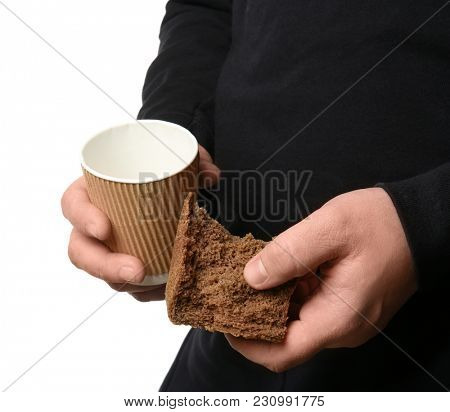 Poor man with cup and piece of bread, isolated on white