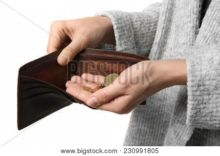 Poor woman holding purse with coins on white background