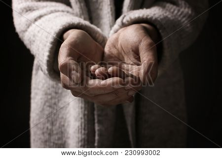 Poor woman begging for money, closeup