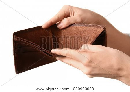 Poor woman showing her empty purse, isolated on white