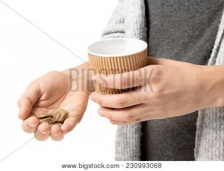 Poor woman with cup and coins, isolated on white