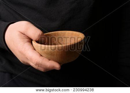 Poor man with bowl, closeup
