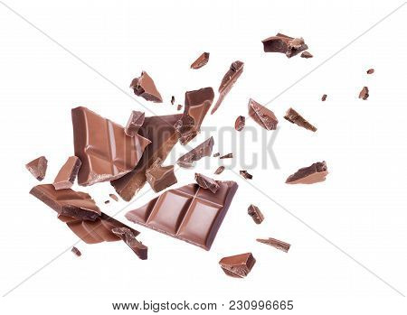 Сhocolate Broken Into Pieces In The Air, Isolated On A White Background