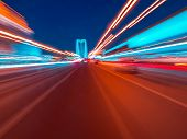 Speed motion on the neon glowing road at dark. Speed motion on the road. Colored light streaks acceleration. Abstract illustration. Blue and Orange Yellow motion streaks. poster