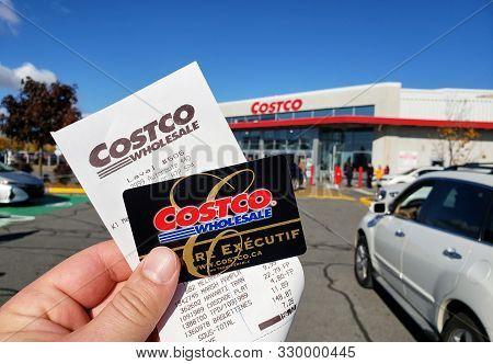 Montreal, Canada - October 26, 2019: A Hand Holding A Receipt And Costco Membership Card In Costco W