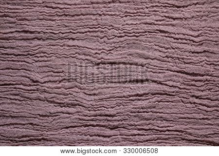 Brown Fabric Mesh. Close Up Rumpled Cloth Background.