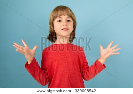 A Teenage Caucasian Boy In A Red Jaket Have Irritate, Picture Isolated On Blue Background.