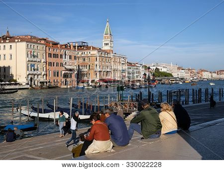 Venice/italy - October 20, 2019: Tourists Sitting On The Steps Near Basilica Di Santa Maria Della Sa