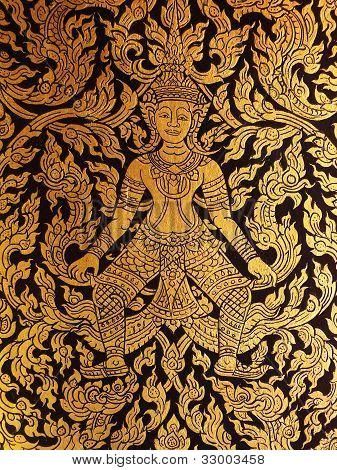 Thai golden painting art on the door of ancient tripitaka building.